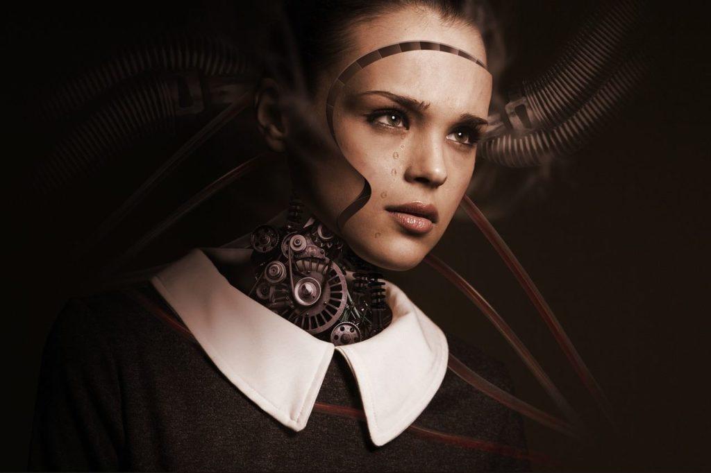 Робот с женским лицом, символизирующий автоматическое действие